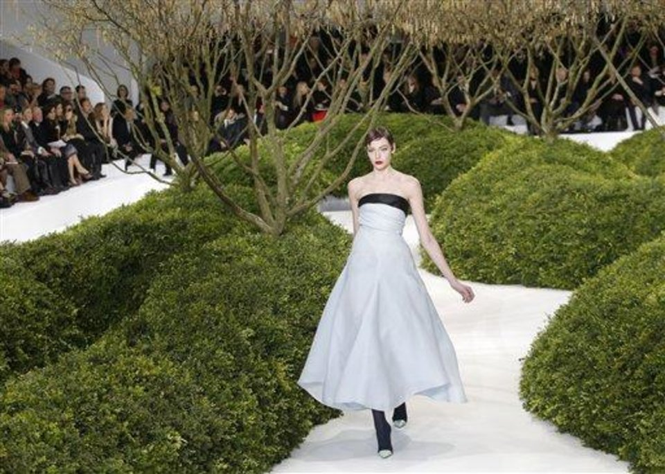 Photo - A model presents a creation by Raf Simons for Christian Dior's Spring Summer 2013 Haute Couture fashion collection, presented in Paris, Monday, Jan.21, 2013. (AP Photo/Christophe Ena)