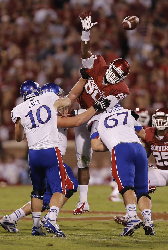 Photo - OU's Jordan Phillips (80) defends on a pass by KU's Dayne Crist (10) during the college football game between the University of Oklahoma Sooners (OU) and the University of Kansas Jayhawks (KU) at Gaylord Family-Oklahoma Memorial Stadium on Saturday, Oct. 20th, 2012, in Norman, Okla. Photo by Chris Landsberger, The Oklahoman