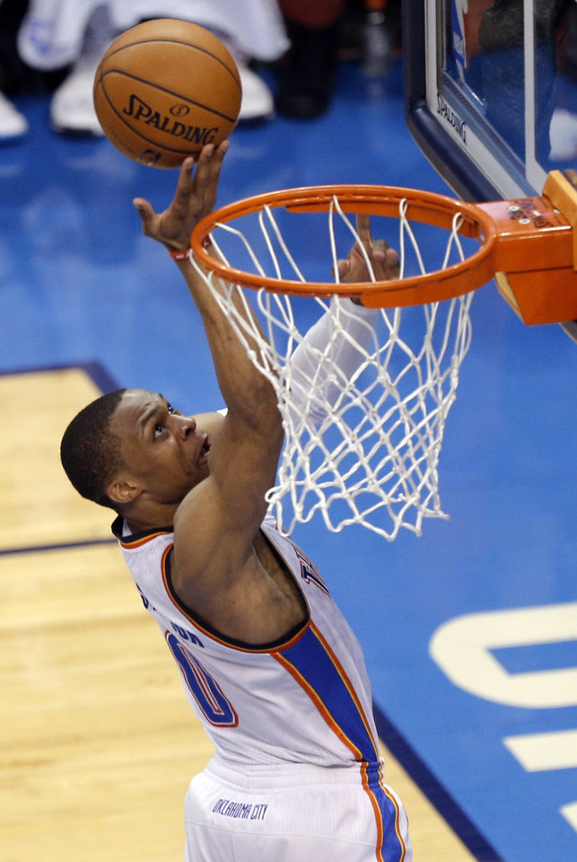 Photo - Oklahoma City's Russell Westbrook (0) shoots during Game 7 in the first round of the NBA playoffs between the Oklahoma City Thunder and the Memphis Grizzlies at Chesapeake Energy Arena in Oklahoma City, Saturday, May 3, 2014. Photo by Sarah Phipps, The Oklahoman