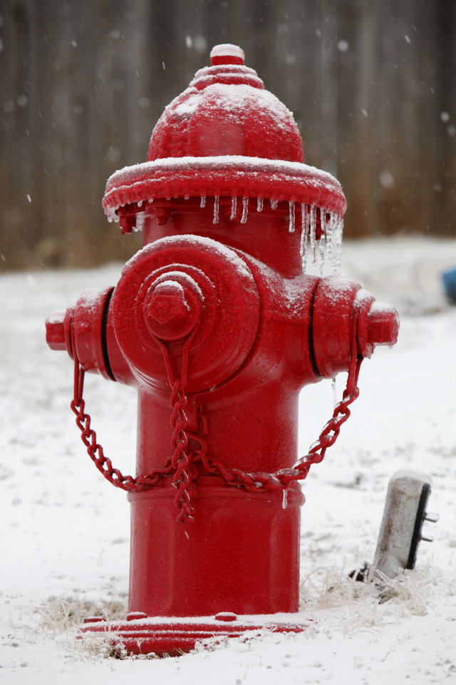 Photo - Icicles form on this fire hydrant in Edmond, OK, Friday, Jan. 29, 2010. By Paul Hellstern, The Oklahoman