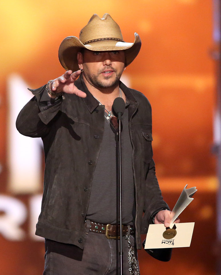 Photo - Jason Aldean accepts the award for entertainer of the year at the 51st annual Academy of Country Music Awards at the MGM Grand Garden Arena on Sunday, April 3, 2016, in Las Vegas. (Photo by Matt Sayles/Invision/AP)