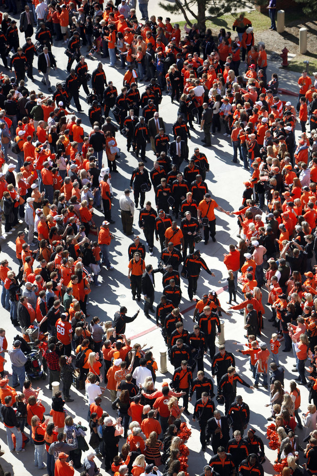 Photo - OSU players enter the stadium during the Spirit Walk before a college football game between the Oklahoma State University Cowboys (OSU) and the Baylor University Bears (BU) at Boone Pickens Stadium in Stillwater, Okla., Saturday, Oct. 29, 2011. Photo by Sarah Phipps, The Oklahoman