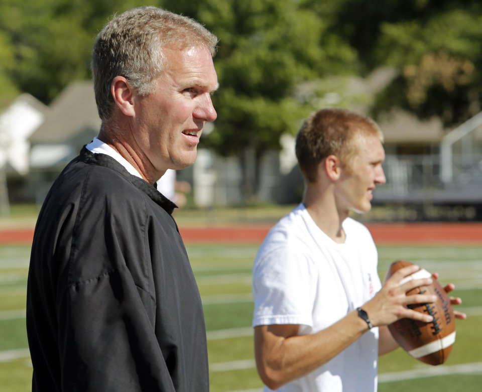 ZACHARY LONG: Former University of Oklahoma (OU) assistant football coach Chuck Long works with his son Zachary at Norman High School on Thursday, July 19, 2012 in Norman, Okla. Photo by Steve Sisney, The Oklahoman