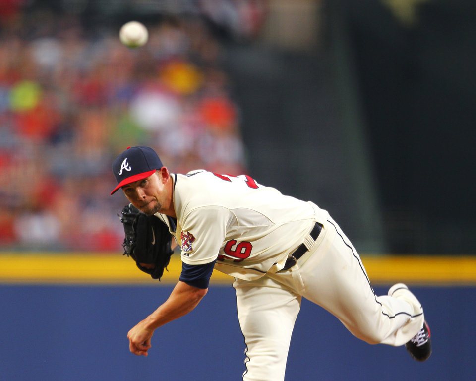 Photo - Atlanta Braves starting pitcher Mike Minor (36) delivers in the first inning inning of a baseball game against the Los Angeles Angels, Sunday, June 15, 2014, in Atlanta. (AP Photo/Todd Kirkland)