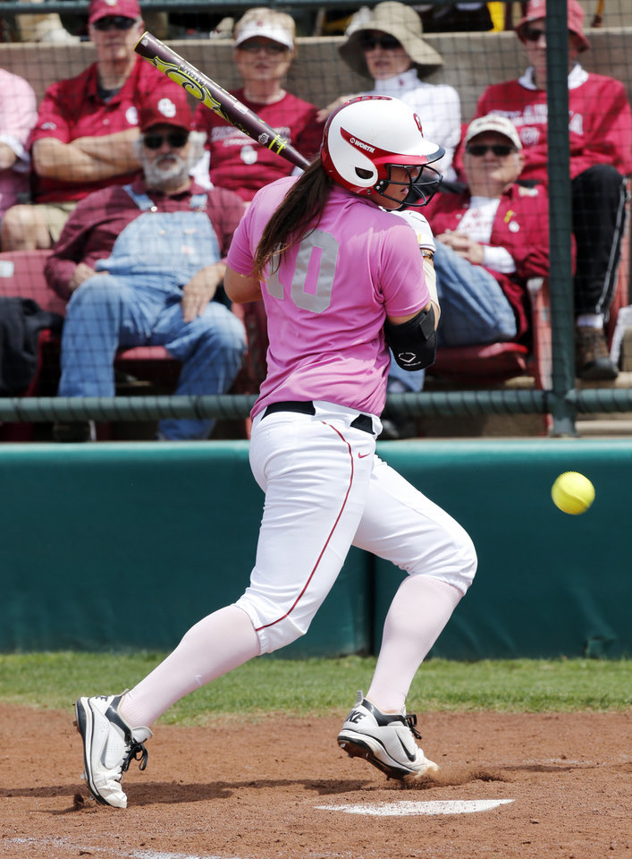 Keilani Ricketts is hit by a pitch as the University of Oklahoma (OU) Sooners play the Baylor Bears in NCAA college softball at Marita Hines Field on Saturday, April 6, 2013  in Norman, Okla. Photo by Steve Sisney, The Oklahoman