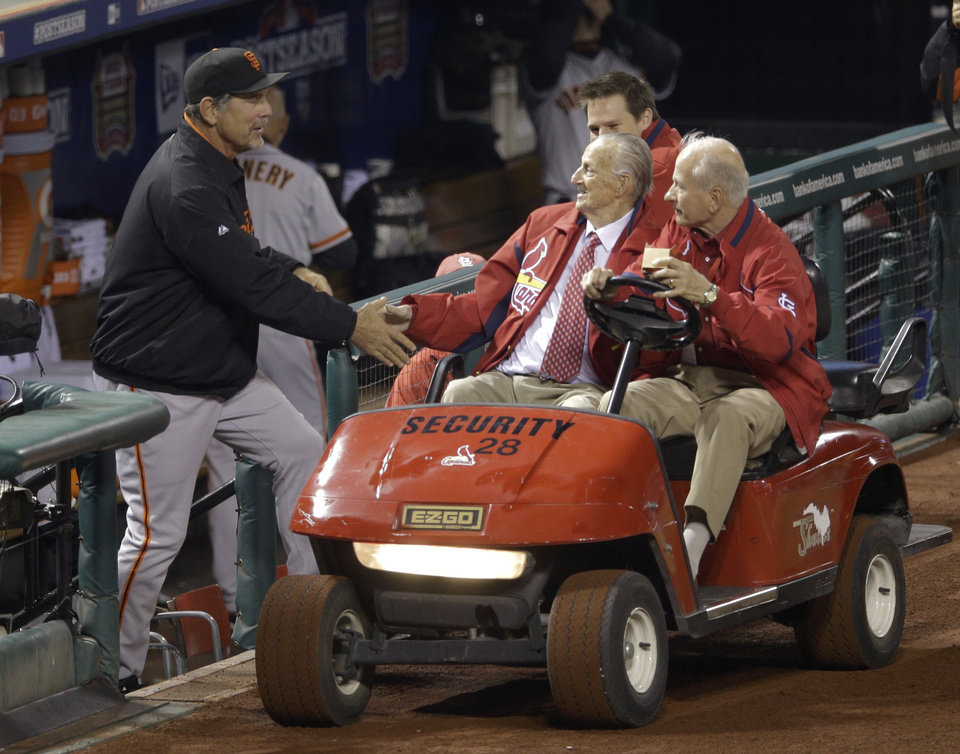 Photo -   San Francisco Giants manager Bruce Bochy shakes hands with Stan Musial before Game 4 of baseball's National League championship series against the St. Louis Cardinals Thursday, Oct. 18, 2012, in St. Louis. (AP Photo/Patrick Semansky)