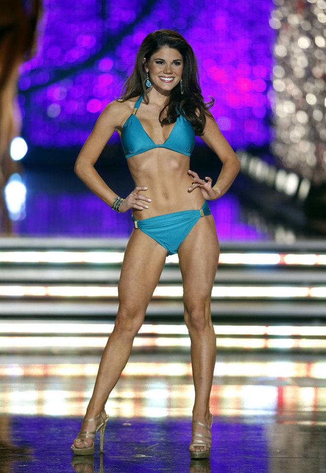 Photo - Miss Maryland Johanna Guy competes in the swimsuit portion Miss America pageant on Saturday, Jan. 12, 2013, in Las Vegas. (AP Photo/Isaac Brekken)