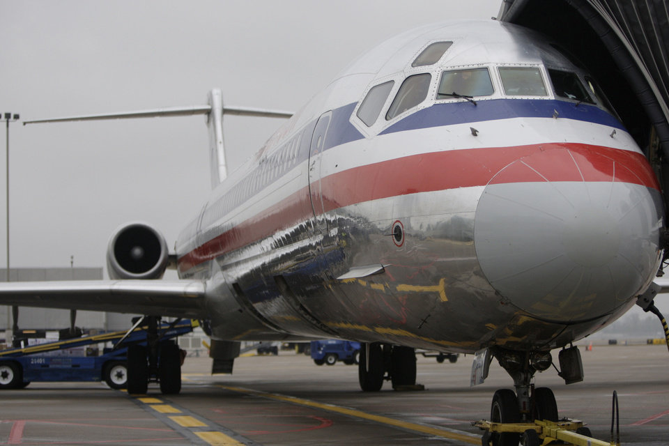Photo - FILE -     AIRPLANE / PLANE: In this Oct. 28, 2009 file photo, an American Airlines jet is seen at Lambert St. Louis International Airport in St. Louis. American Airlines said Friday, Jan. 22, 2010, it will lay off up to 175 pilots beginning next month because it needs fewer pilots after cutting some flights.(AP Photo/Jeff Roberson, file) ORG XMIT: NYBZ165