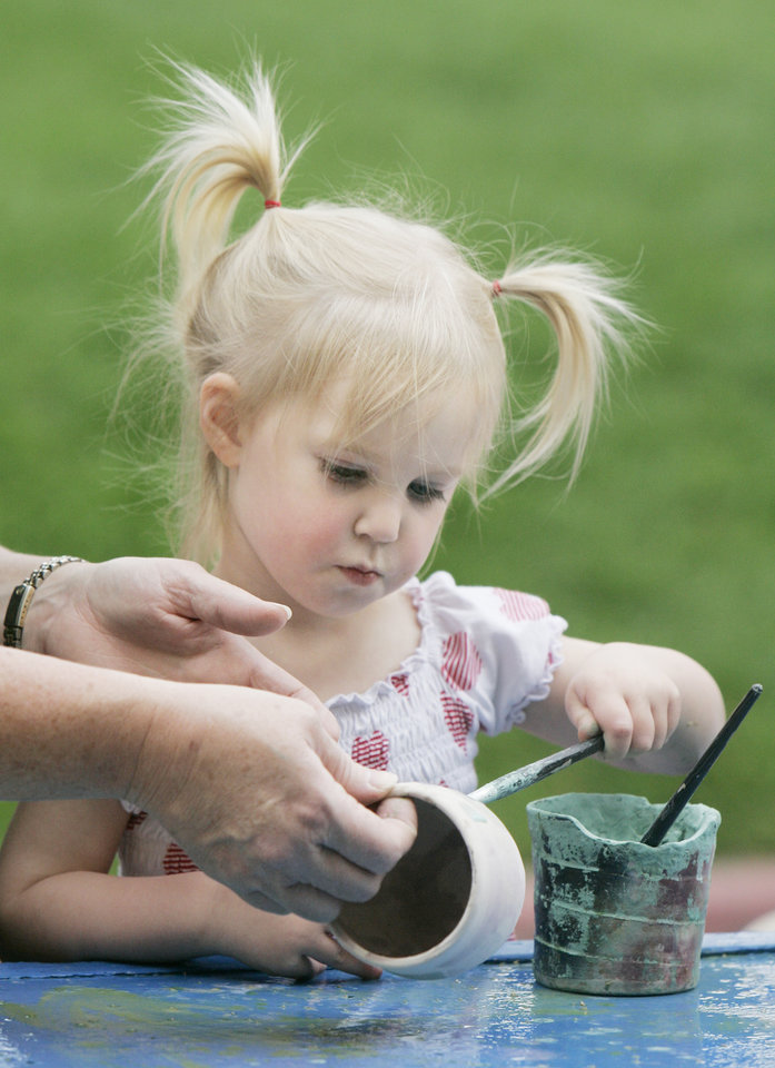 Claire Shons, 2, of OKC, decorates a bowl at the pottery place at the Festival of the Arts Wed. April 23, 2008 in downtown OKC. BY JACONNA AGUIRRE/THE OKLAHOMAN.