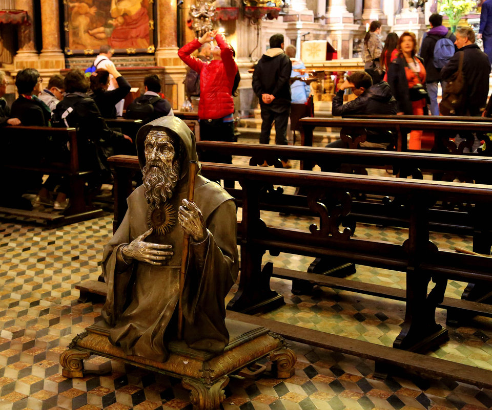 Photo - In this May 2, 2014 photo, the just-cleaned top half of a statue waits to be lifted back into place in the Naples Cathedral in Naples, Italy. The lavishly decorated cathedral was completed in the early 14th century. (AP Photo/Michelle Locke)