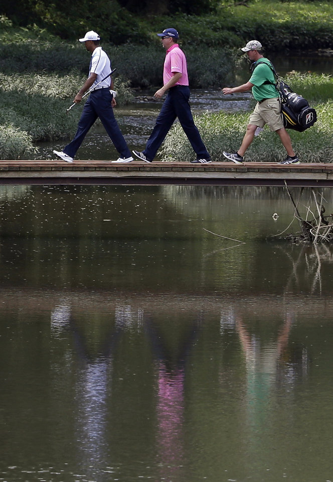 Photo - Tiger Woods, left, and Davis Love III walk to the sixth tee during a practice round for the PGA Championship golf tournament at Valhalla Golf Club on Wednesday, Aug. 6, 2014, in Louisville, Ky. The tournament is set to begin on Thursday. (AP Photo/David J. Phillip)