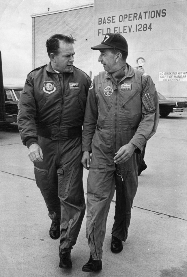 Gov. Henry Bellmon and Col. Doyle Hasite of the Oklahoma Air National Guard prepare for a trip to the Far East. 10/15/1965