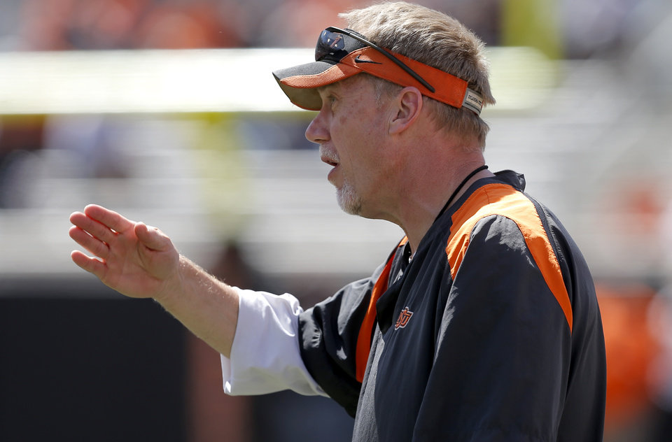 Photo -  Oklahoma State defensive coordinator Glenn Spencer talks with his team OSU's spring football game at Boone Pickens Stadium in Stillwater, Okla., Sat., April 20, 2013. Photo by Bryan Terry, The Oklahoman