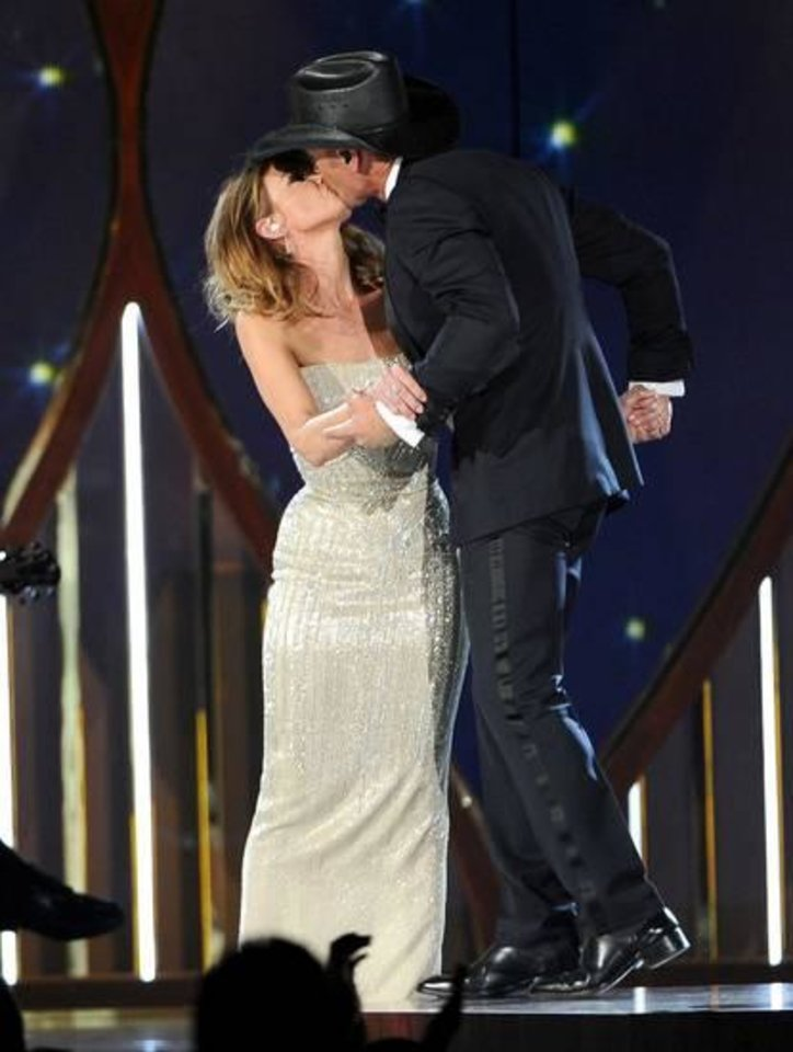 Photo -  Faith Hill, left, and Tim McGraw kiss on stage at the 49th annual Academy of Country Music Awards at the MGM Grand Garden Arena on Sunday, April 6, 2014, in Las Vegas. (AP)