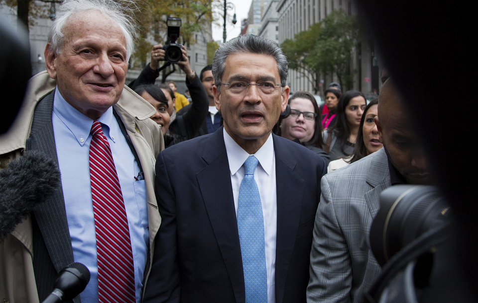 Photo -   Rajat Gupta, center, leaves federal court in New York on Wednesday, Oct. 24, 2012 after the former Goldman Sachs and Procter & Gamble Co. board member was sentenced Wednesday to 2 years in prison for feeding inside information about board dealings with a billionaire hedge fund owner who was his friend. At left is Gupta's attorney, Gary Naftalis. (AP Photo/Craig Ruttle)