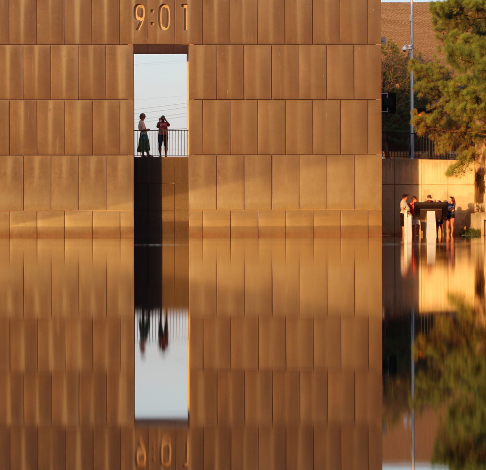 Photo -  @twharms   This was during the Neighborhood Film Instameet. I made it to the Memorial before the rest of the crowd, and I couldn't resist this color from the setting sun. It wasn't yet that vivid gold, but I thought it was perfect. I love reflections and this just stopped me in my tracks. I'm always amazed at this place. Such beauty in a place of such tragedy. I remember watching the rescue workers climbing through the rubble looking for any signs of life. Those emotions run through my mind every time and tears always flow. But then beauty like this happens, and I remember what an incredible people we live with here in this state.