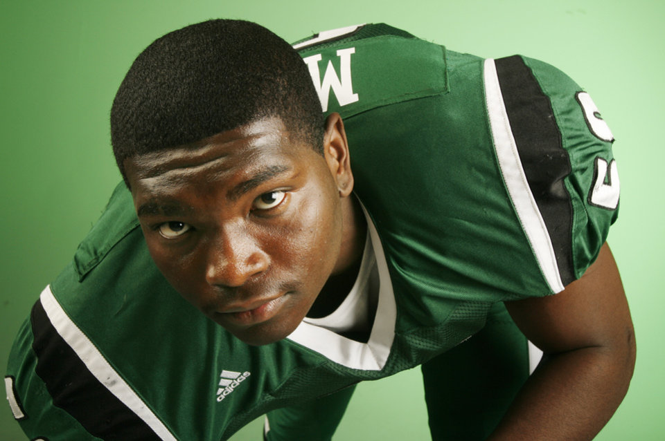 Stacy McGee, Muskogee, poses for a photo in the OPUBCO studio for The Oklahoman\'s All-State Football Team, in Oklahoma City, Wednesday, Dec. 12, 2007. By Nate Billings, The Oklahoman