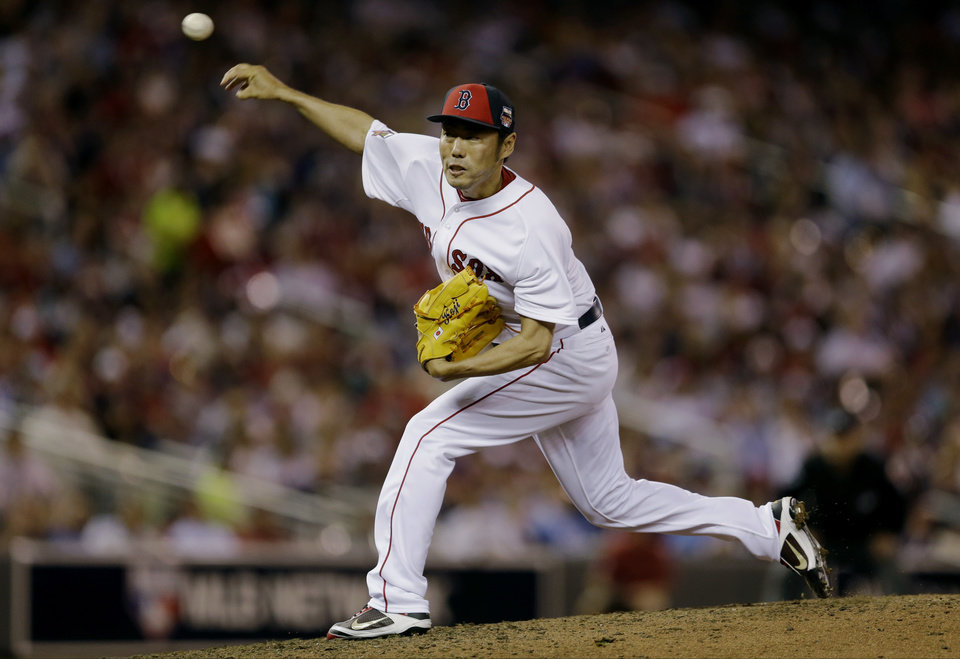 Photo - American League pitcher Koji Uehara, of the Boston Red Sox, throws during the sixth inning of the MLB All-Star baseball game, Tuesday, July 15, 2014, in Minneapolis. (AP Photo/Jeff Roberson)