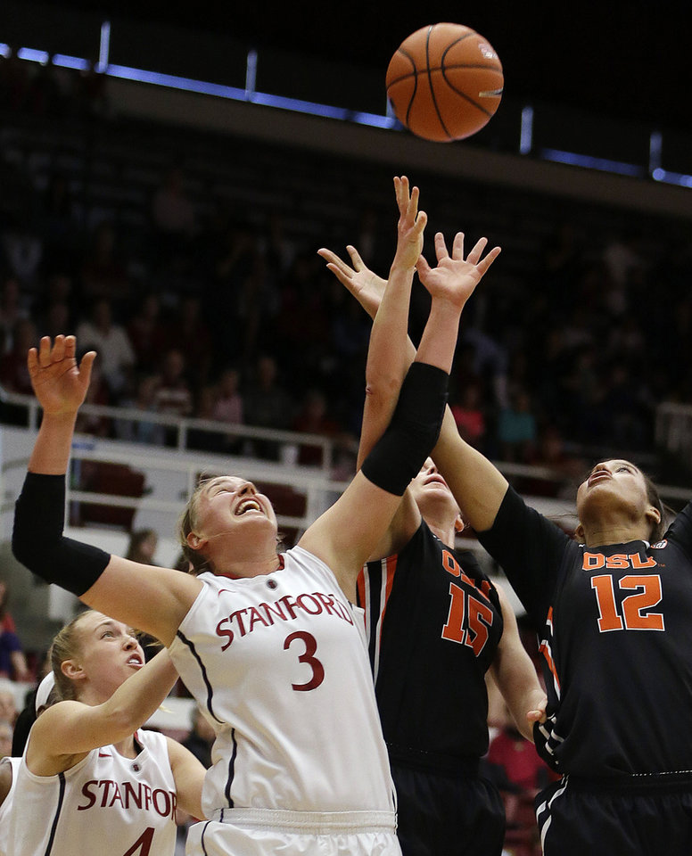 Photo - Oregon State's Kolbie Orum, right, and Stanford's Mikaela Ruef (3) fight for a rebound during the first half of an NCAA college basketball game Sunday, Jan. 5, 2014, in Stanford, Calif. (AP Photo/Ben Margot)