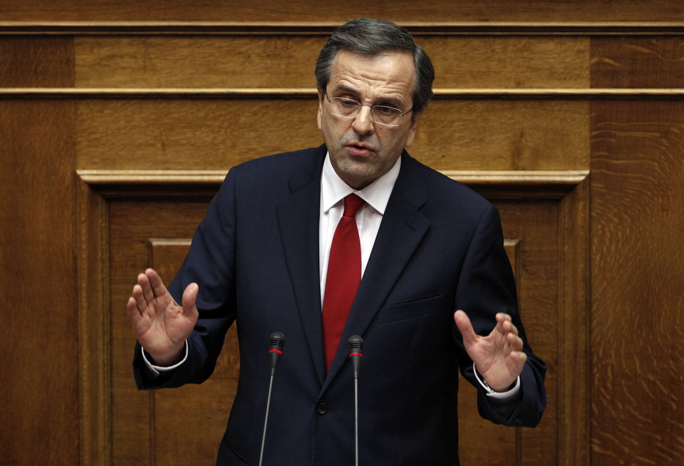 Photo -   Greek Prime Minister Antonis Samaras speaks at the Parliament during a debate on the new government's policy agenda before staging a vote of confidence in Athens, late Sunday July 8, 2012. (AP Photo/Kostas Tsironis)