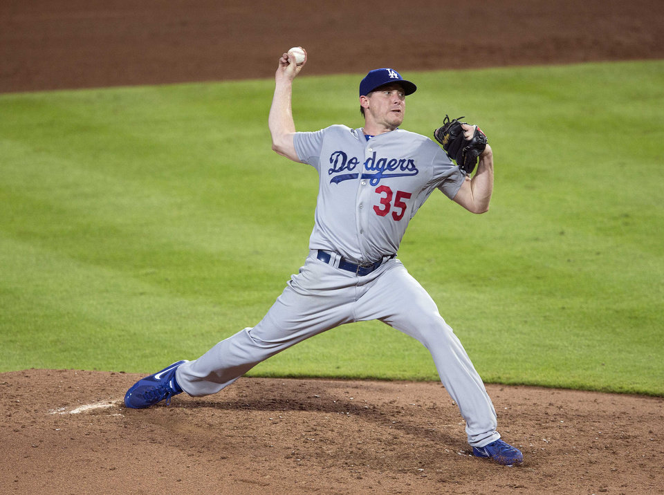 Photo - Los Angeles Dodgers pitcher Kevin Correia works in the sixth inning of a baseball game against the Atlanta Braves  Monday, Aug. 11, 2014 in Atlanta.  (AP Photo/John Bazemore)