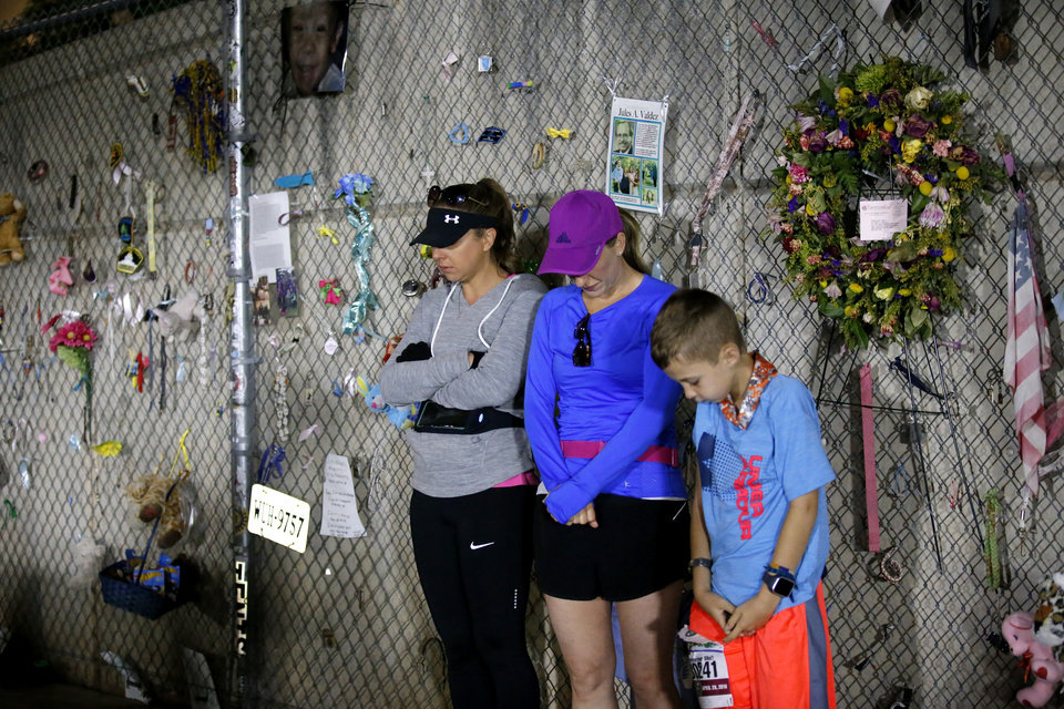 Photo - People pray before Oklahoma City Memorial Marathon in Oklahoma City, Sunday, April 28, 2019. [Sarah Phipps/The Oklahoman]