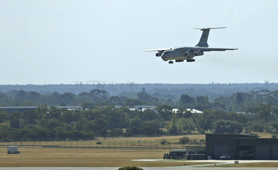 Photo - A Chinese  Ilyushin IL-76 aircraft lands at Perth International Airport after returning from the ongoing search operations for missing Malaysia Airlines Flight 370 in Perth, Australia, Sunday, April 13, 2014. Following four strong underwater signals in the past week, all has gone quiet in the hunt for the missing Malaysian airline, meaning the batteries on the all-important black boxes may have finally died. Despite having no new pings to go on, crews are continuing their search Sunday for debris and any sounds that could still be emanating. (AP Photo/Rob Griffith)