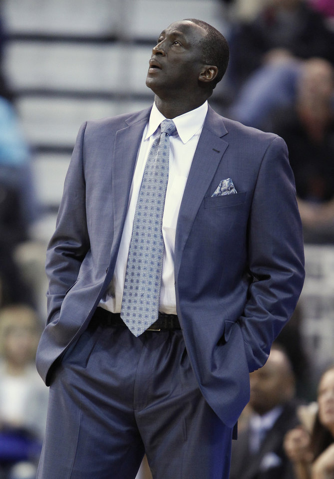 Photo - Utah Jazz's head coach Tyrone Corbin glances at the scoreboard during a game against the Cleveland Cavaliers during the first half of an NBA basketball game in Salt Lake City, Friday, Jan. 10, 2014. Cavaliers defeated the Jazz 113-102. (AP photo/George Frey)