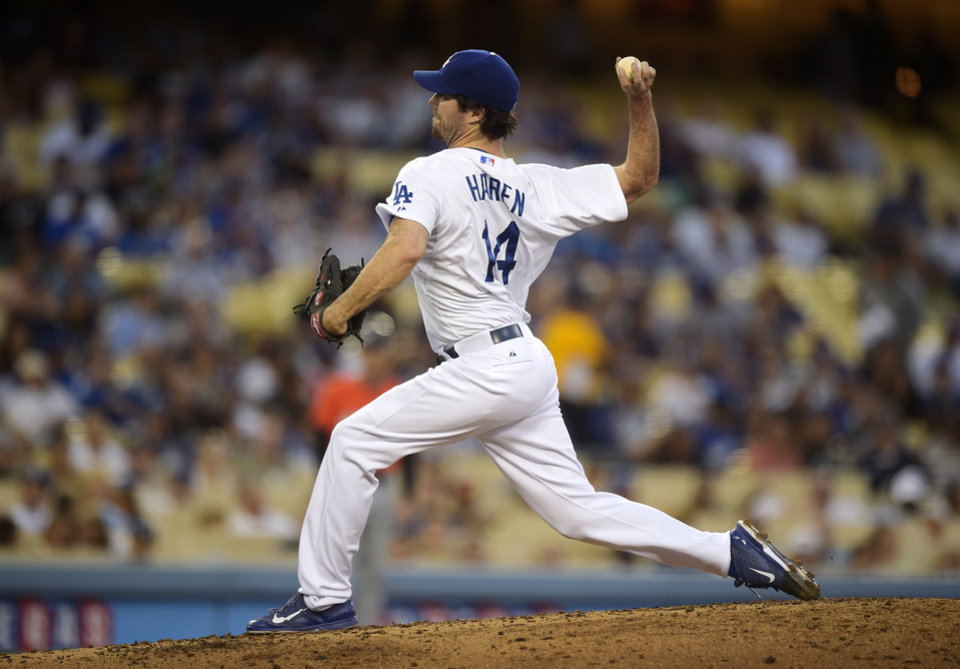 Photo - Los Angeles Dodgers starting pitcher Dan Haren throws to the plate during the second inning of a baseball game against the Miami Marlins, Monday, May 12, 2014, in Los Angeles.  (AP Photo)