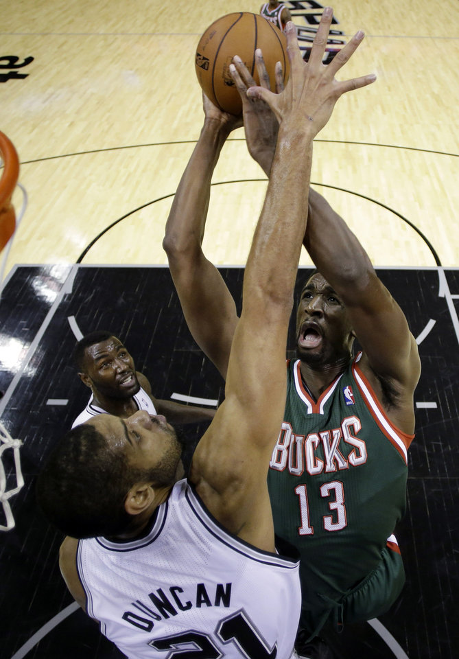 Milwaukee Bucks' Ekpe Udoh (13) shoots over San Antonio Spurs defender Tim Duncan, left, during the first quarter of an NBA basketball game on Wednesday, Dec. 5, 2012, in San Antonio. San Antonio won 99-95. (AP Photo/Eric Gay)