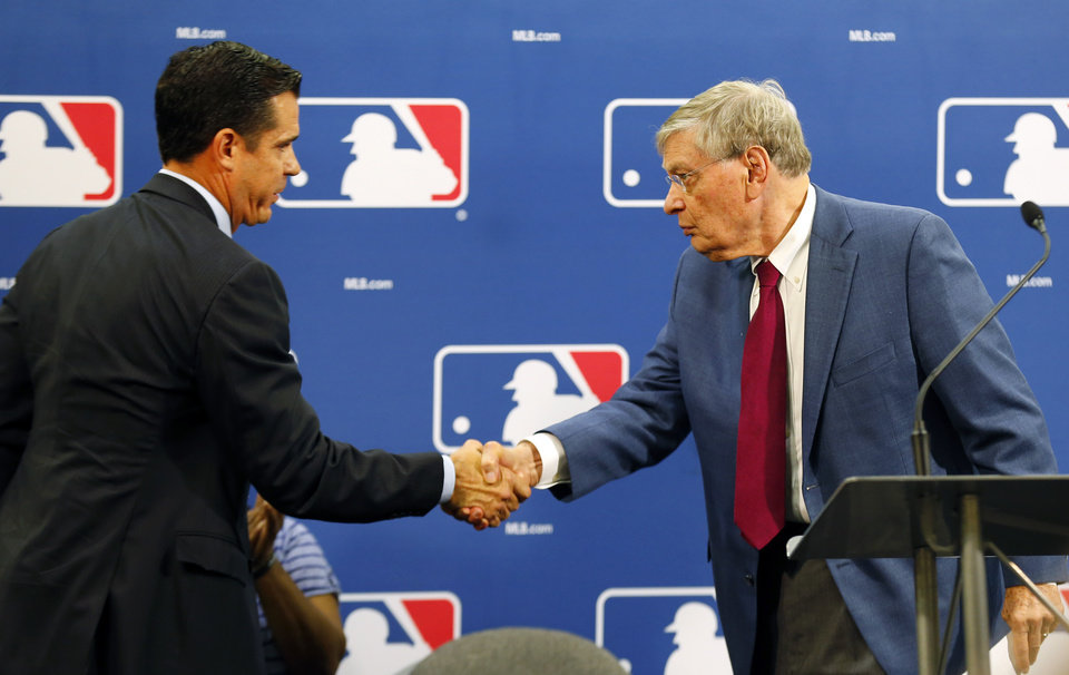 Photo - Baseball Commissioner Bud Selig, right, greets former major league outfielder Billy Bean during a news conference at baseball's All-Star game, Tuesday, July 15, 2014, in Minneapolis. Major League Baseball has appointed Bean, who came out as gay after his playing career, to serve as a consultant in guiding the sport toward greater inclusion and equality. (AP Photo/Paul Sancya)