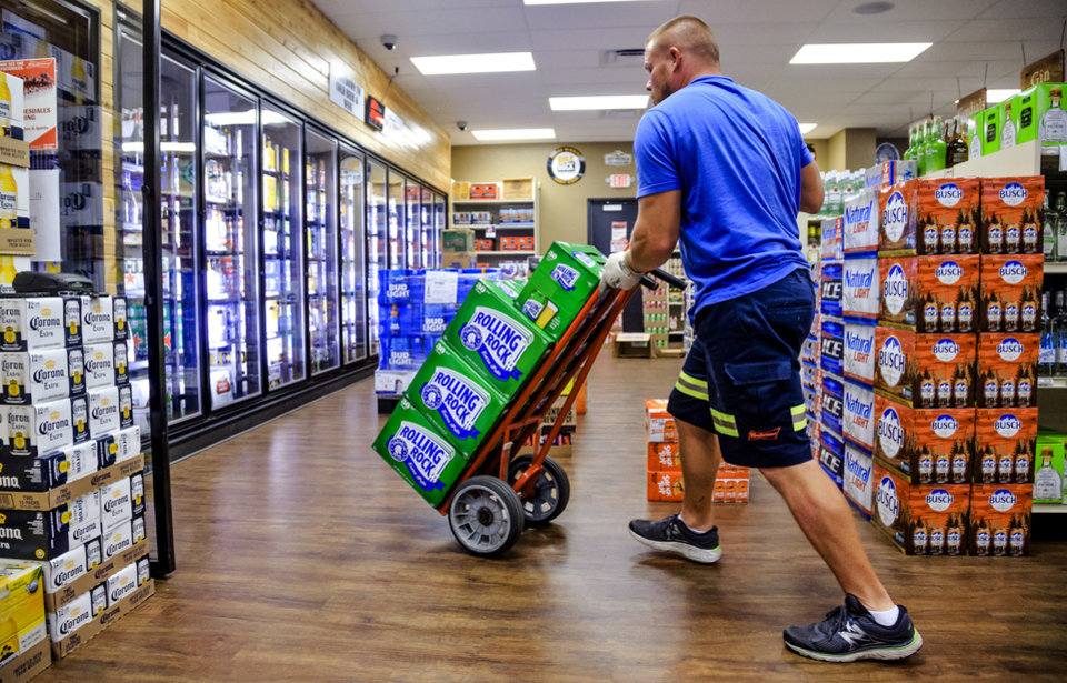 Photo - Work is being done to get the store's coolers stocked with high point beer at Midwest Wine & Spirits in Midwest City, Okla. on Wednesday, Sept. 26, 2018. Photo by Chris Landsberger, The Oklahoman