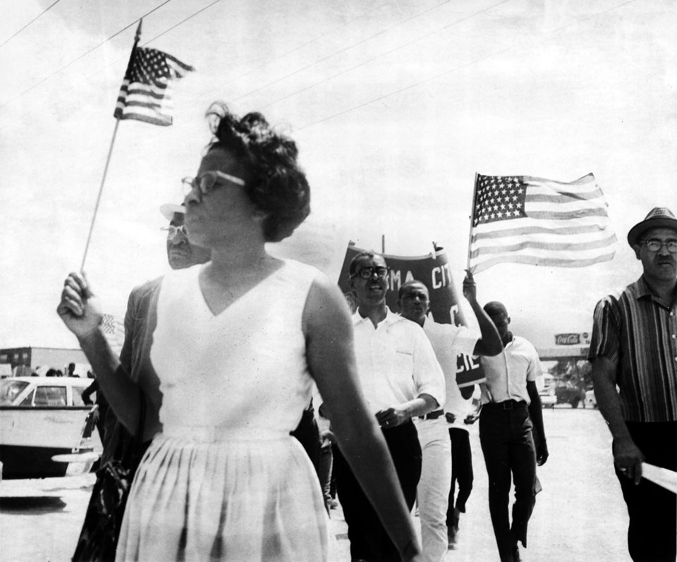 Photo - Demonstrators led by Mrs. Clara Luper of Oklahoma City march along Sheridan Road in Lawton enroute to Doe Doe park to protest a segregation policy barring Negroes from the swimming pool. Staff photo taken 6/11/1966; photo ran in the 6/12/1966 Daily Oklahoman.