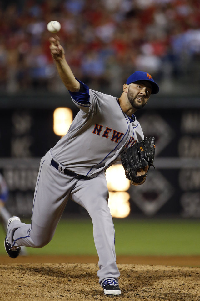 Photo - New York Mets' Dillon Gee pitches during the third inning of a baseball game against the Philadelphia Phillies, Saturday, Aug. 9, 2014, in Philadelphia. (AP Photo/Matt Slocum)