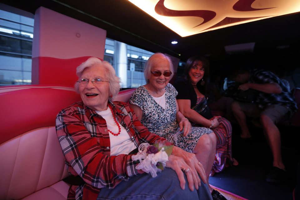 Photo - Sadie Fanali, left, and Lorraine Thomas ride in a pink limousine after meeting for the first time at Will Roger World Airport, Friday, June 14, 2013, in Oklahoma City.  The pair have been pen pals since 1932. Photo by Sarah Phipps, The Oklahoman