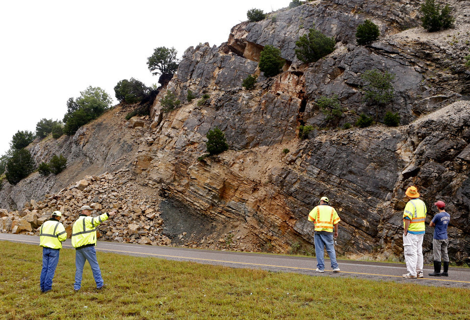 Photo - A section of Interstate 35 at the 50 mile marker is closed because of a rock slide on Thursday, June 18, 2015 in Davis, Okla. A huge gap in the surface is a concern for ODOT workers.  Photo by Steve Sisney, The Oklahoman