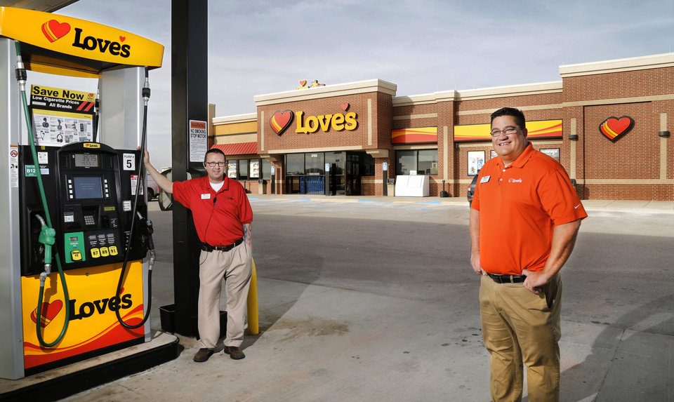 Photo -  Love's Travel Stops District Manager Dan West, right, and Operations Manager Chris Hendricks are seen at a Love's in Guthrie along northbound Interstate 35. [Photos by Jim Beckel, The Oklahoman]