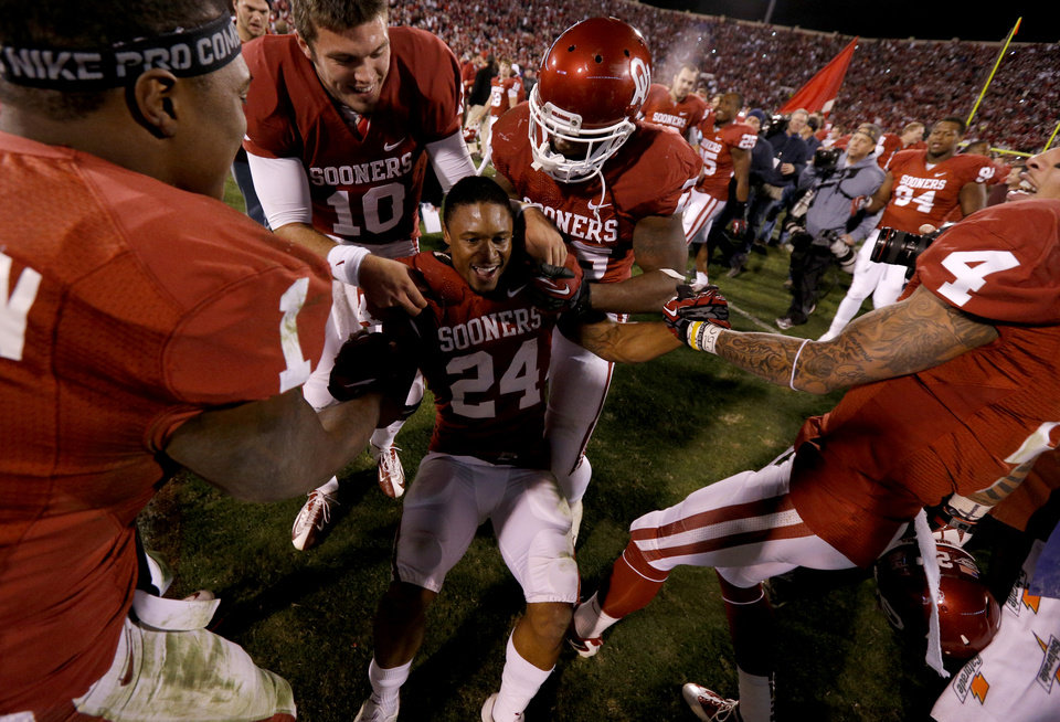 Photo - Oklahoma's Brennan Clay (24) celebrates after the Bedlam college football game between the University of Oklahoma Sooners (OU) and the Oklahoma State University Cowboys (OSU) at Gaylord Family-Oklahoma Memorial Stadium in Norman, Okla., Saturday, Nov. 24, 2012. Oklahoma won 51-48. Photo by Bryan Terry, The Oklahoman
