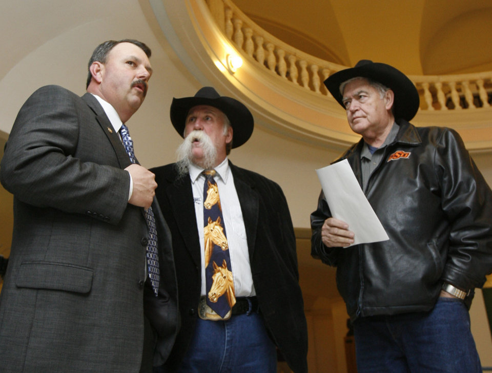 Photo - Rep. Don Armes, chairman of the House Agriculture Committee, Oklahoma City Blazers head coach Doug Sauter, and horse owner Don Rogers talk at the state Capitol building in Oklahoma City, OK, Tuesday, April 7, 2009 during a rally for a law that would allow them to care for their horses' teeth and hooves. BY PAUL HELLSTERN, THE OKLAHOMAN ORG XMIT: KOD