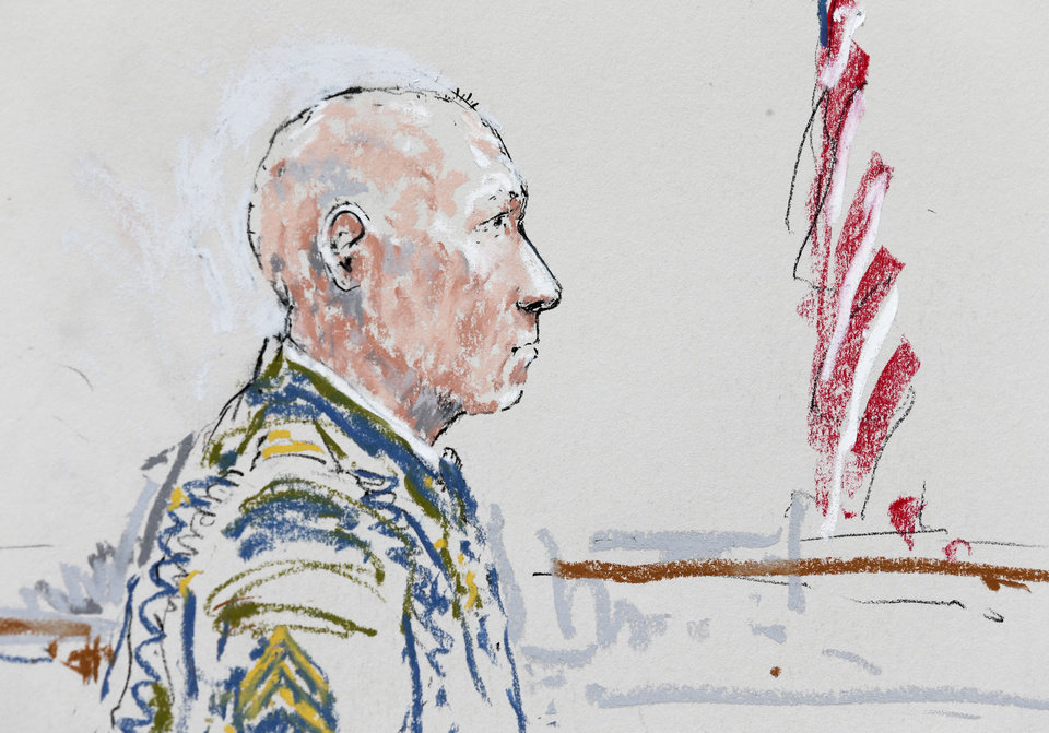 Photo - In this detail from a courtroom sketch, U.S. Army Staff Sgt. Robert Bales appears Wednesday, June 5, 2013 during a plea hearing in a military courtroom at Joint Base Lewis-McChord in Washington state. Bales is accused of 16 counts of premeditated murder and six counts of attempted murder for a pre-dawn attack on two villages in Kandahar Province in Afghanistan in March, 2012. (AP Photo/Peter Millett)