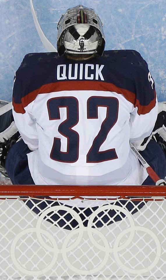 Photo - USA goaltender Jonathan Quick stands in the net turing the sencond period of the game against Slovakia at the 2014 Winter Olympics men's ice hockey tournament at Shayba Arena, Thursday, Feb. 13, 2014, in Sochi, Russia. (AP Photo/Matt Slocum)