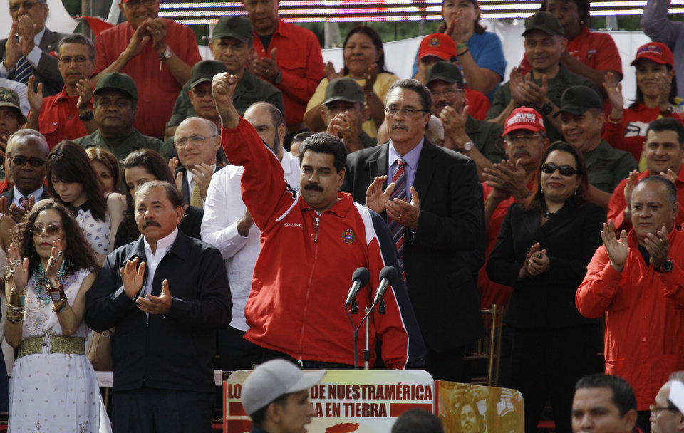Venezuela\'s Vice President Nicolas Maduro, center, pumps his fist in the air during a symbolic inauguration for Venezuela\'s President Hugo Chavez outside Miraflores presidential palace, as National Assembly President Diosdado Caballo, right, looks on in Caracas, Venezuela, Thursday, Jan. 10, 2013. At left are Nicaragua\'s President Daniel Ortega and wife Rosario Murillo. The government organized the unusual show of support for the cancer-stricken leader on the streets outside Miraflores Palace on what was supposed to be his inauguration day. Maduro said that even though it wasn\'t an official swearing-in, Thursday\'s event still marks the start of a new term for the president following his re-election in October. (AP Photo/Fernando Llano)