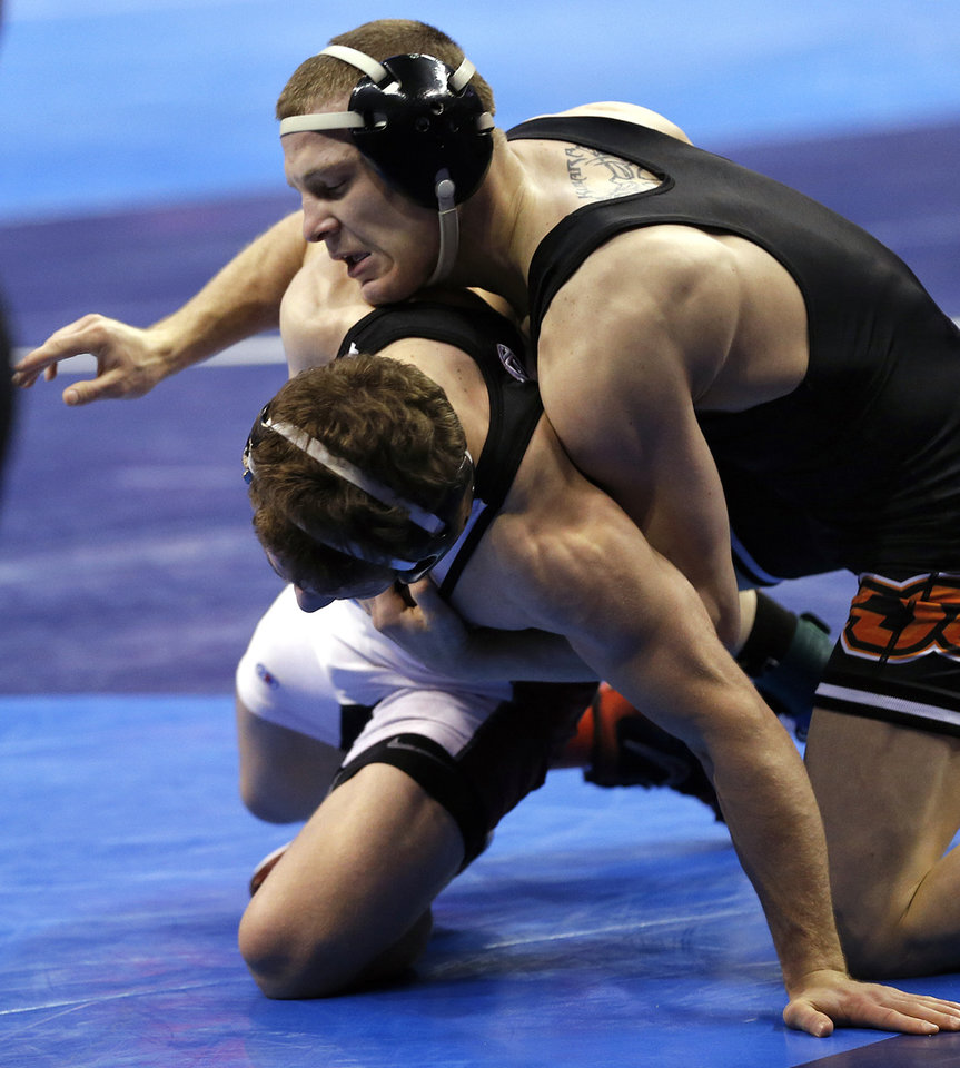 Photo - Oklahoma State's Edward Kilmara takes on Stanford's Evan Silver in the 125 pound match during the 2014 NCAA Div. 1 Wrestling Championships at Chesapeake Energy Arena in Oklahoma City, Okla. on Friday, March 21, 2014. Photo by Chris Landsberger, The Oklahoman