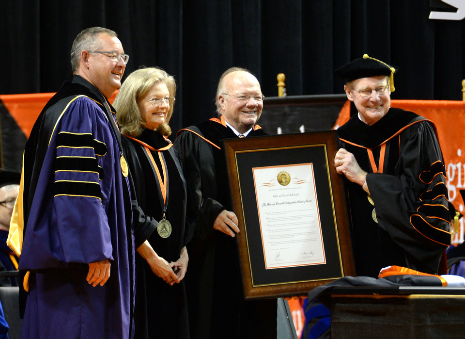 Photo - Ross and Billie McKnight receive the Bennett award during the Oklahoma State University Spring 2016 commencement ceremony in Gallagher-Iba Arena in Stillwater, Oklahoma on Saturday May 7, 2016. Jackie Dobson for the Oklahoman