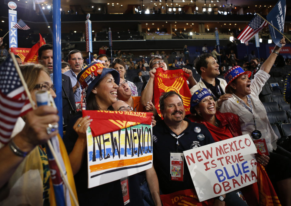 Photo -   New Mexico delegates cheer as President Barack Obama is nominated for the Office of the President of the United States at the Democratic National Convention in Charlotte, N.C., on Thursday, Sept. 6, 2012. (AP Photo/Jae C. Hong)