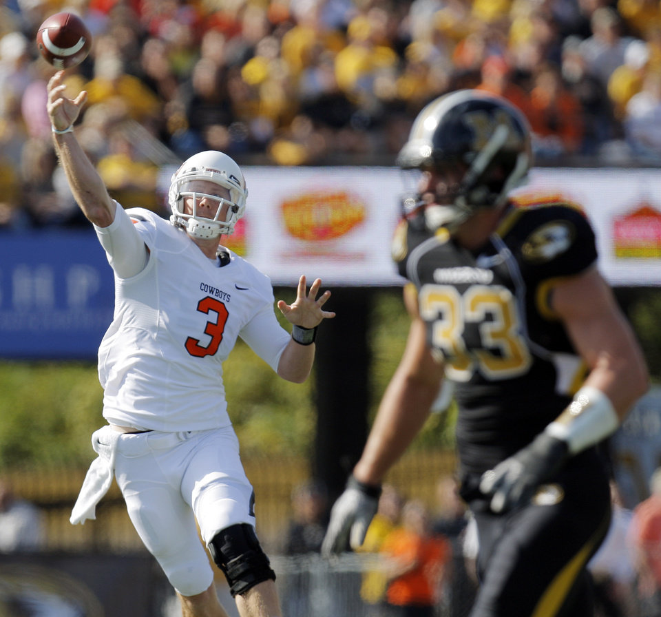 Photo - Oklahoma State's Brandon Weeden (3) throws a touchdown pass as Missouri's Luke Lambert (33) defends in the first quarter during a college football game between the Oklahoma State University Cowboys (OSU) and the University of Missouri Tigers (Mizzou) at Faurot Field in Columbia, Mo., Saturday, Oct. 22, 2011. Photo by Nate Billings, The Oklahoman