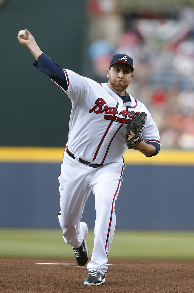 Photo - Atlanta Braves starting pitcher Aaron Harang works in the first inning of a baseball game against Boston Red Sox on Tuesday, May 27, 2014, in Atlanta. (AP Photo/John Bazemore)