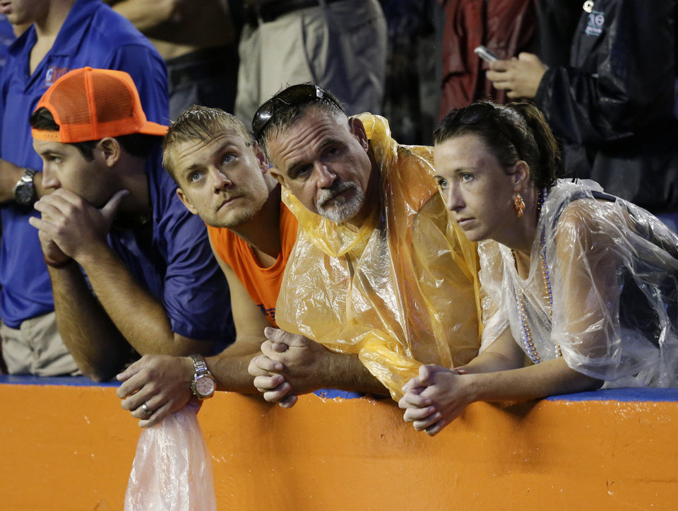 Photo - Football fans show disappointment after an NCAA college football game between Florida and Idaho was delayed because of lightning for the second time in Gainesville, Fla., Saturday, Aug. 30, 2014. (AP Photo/John Raoux)