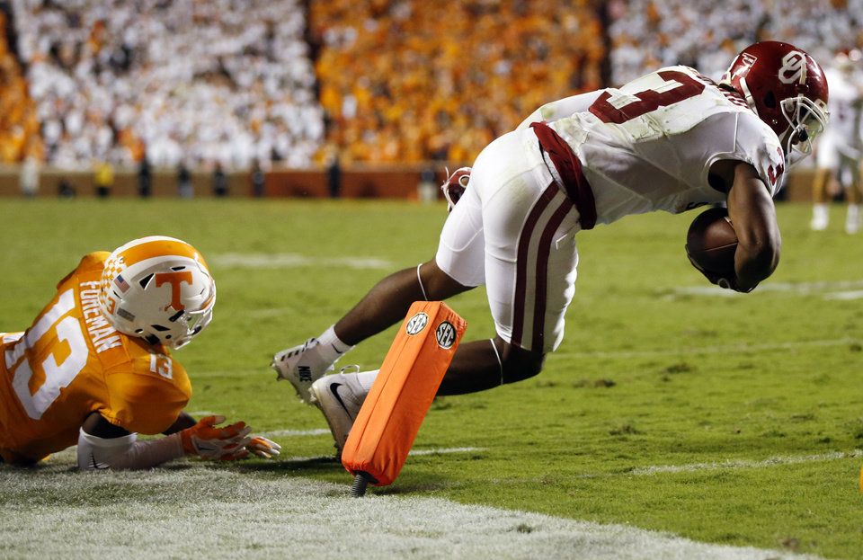 Photo - Oklahoma's Sterling Shepard (3) scores a touchdown past Tennessee's Malik Foreman (13) in double overtime during the college football game between the Oklahoma Sooners (OU) and the Tennessee Volunteers at Neyland Stadium in Knoxville, Tennessee, Saturday, Sept. 12, 2015. OU won 31-24 in double overtime. Photo by Nate Billings, The Oklahoman