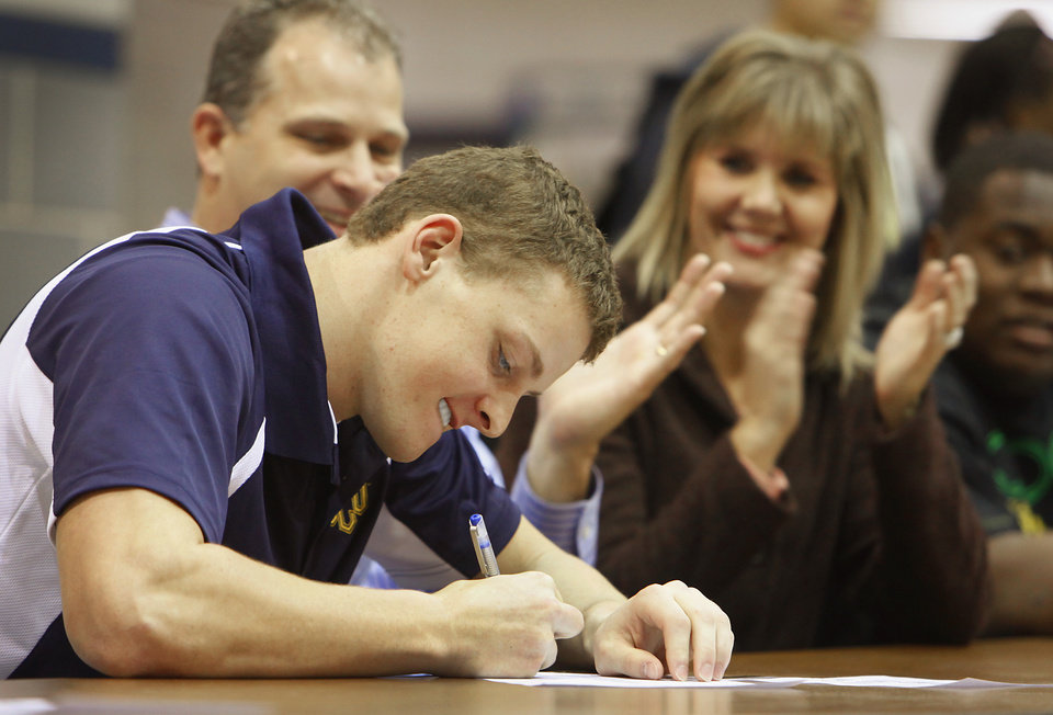 Photo - Edmond North's Blake Gatewood signs a letter of intent to play at Central Oklahoma on Wednesday, Feb. 3, 2010. Photo by David McDaniel, The Oklahoman